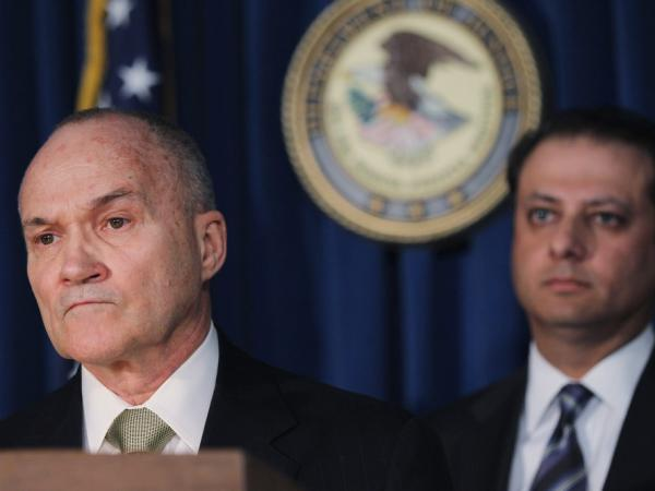 New York Police Department Commissioner Raymond Kelly (left) addresses questions as U.S. Attorney Preet Bharara listens during a news conference announcing the arrest of five police officers in October.