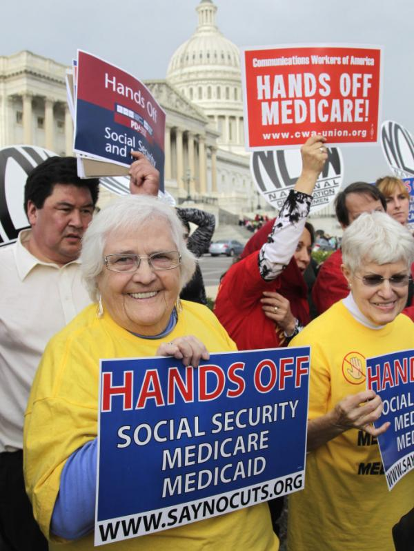 Protesters, joined by members of Congress, voiced their opposition to any cuts in Medicare, Medicaid, and Social Security benefits in Washington, on Oct. 26.