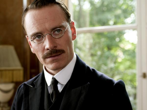 Fassbender's Carl Jung — Sigmund Freud's protege — struggles to reconcile theory and practice in <em>A Dangerous Method</em>.