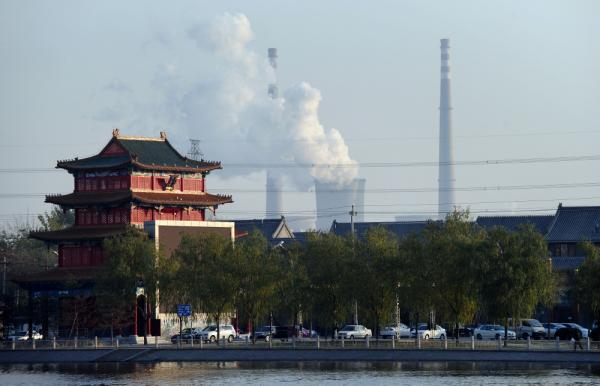 Chimneys of a coal-fired power plant emit smoke on the outskirts of Beijing. China is now the world's largest emitter of carbon dioxide, surpassing the United States about five years ago.
