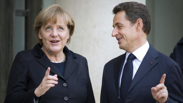 French President Nicolas Sarkozy and German Chancellor Angela Merkel in Paris today (Dec. 5, 2011).