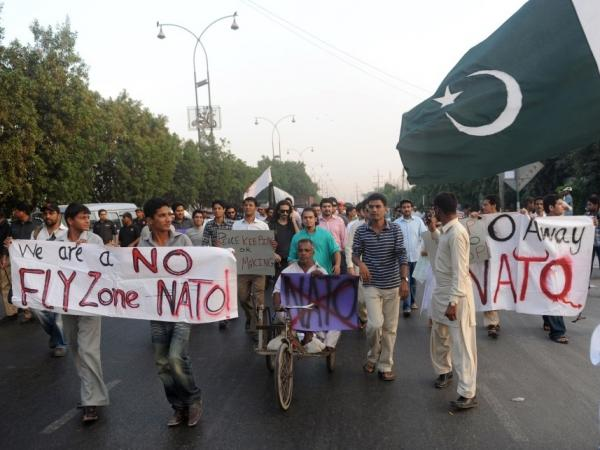 Pakistani students protest the cross-border NATO air strike on Pakistani troops, in a march at the U.S. consulate in Karachi, Dec. 2. Pakistan said it could not attend the Bonn conference on Afghanistan unless its security was ensured.