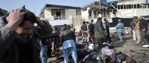 A man grieves as others try to help victims and remove bodies from the scene in Kabul earlier today (Nov. 6, 2011) after a suicide bomb exploded in a crowd of Shiite worshipers.