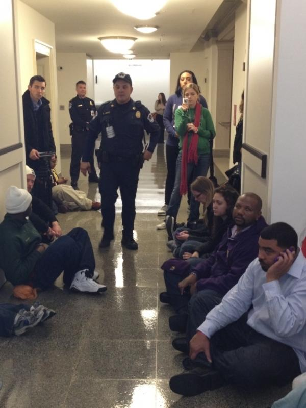 Protesters staged a sit-in outside the offices of Republican Rep. Paul Ryan of Wisconsin on Tuesday.