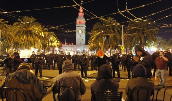 Police officers surrounded the Occupy San Francisco encampment at Justin Herman Plaza early Wednesday.
