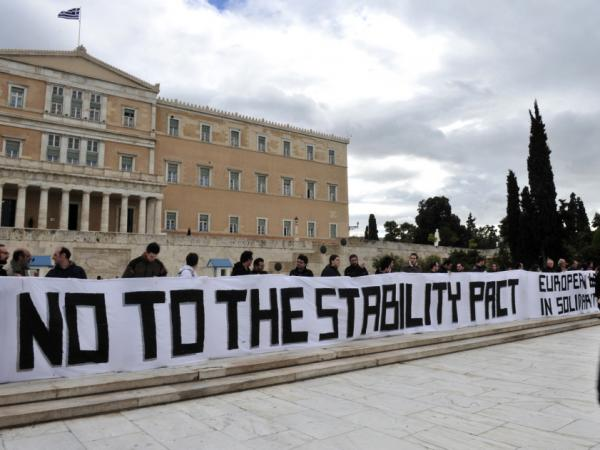 Protestors in front of the Greek Parliament in Athens in 2010, demonstrating against the EU's Growth and Stability Pact.