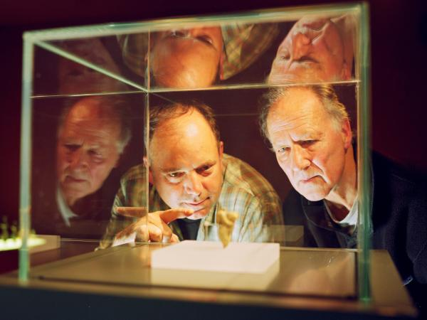 Anthropologist Nicholas Conard (left) and filmmaker Werner Herzog examine artifacts from the Chauvet caves in southern France.