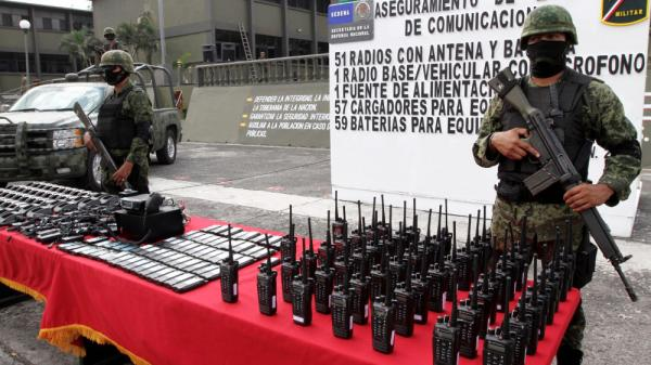 Mexican soldiers stand guard behind communication radios seized from alleged drug-cartel members in Veracruz, Mexico, Nov. 23.