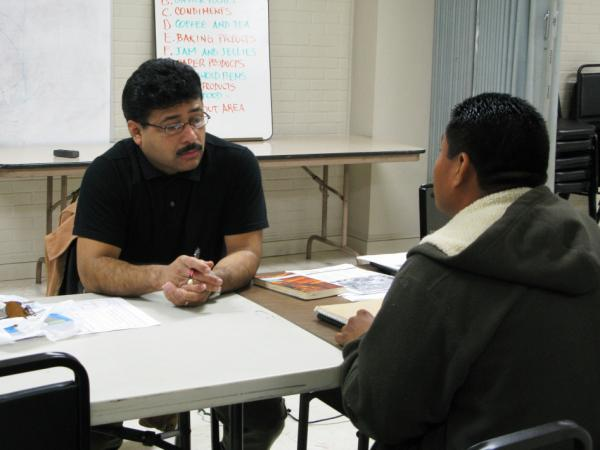 Methodist Pastor Oscar Ramos conducts English classes for Latino immigrants in New Orleans. The majority of the immigrants say they arrived after Katrina to work in reconstruction and intend to stay.