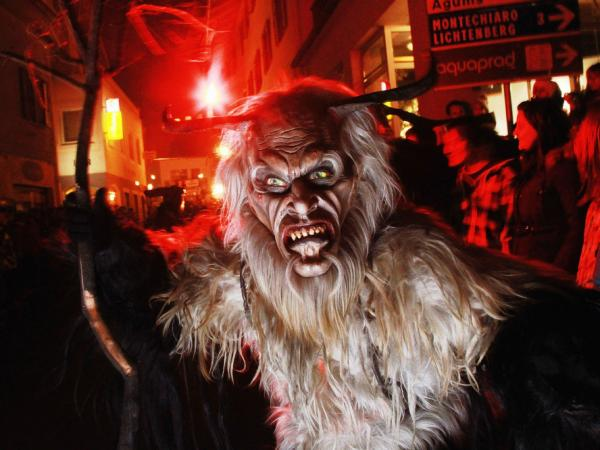 A Krampus procession takes place on Dec. 4 near Merano, Italy. People around America are also taking up the European Alpine folklore tradition, dressing like the creature who steals naughty children around Christmastime.