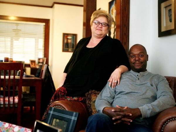 Michelle and Al Ford relax at their home in St. Paul, Minn., before heading to work. The Fords suffered a combination of five layoffs in five years — including a time they each received a pink slip on the same day. Now they're happy to be working again.