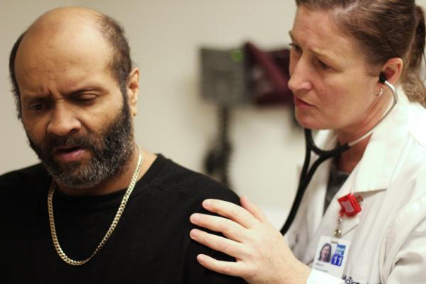 Joseuly Claudio, 53, gets weekly checkups from nurse practitioner Mary McDonagh at Mt. Sinai Hospital in New York.