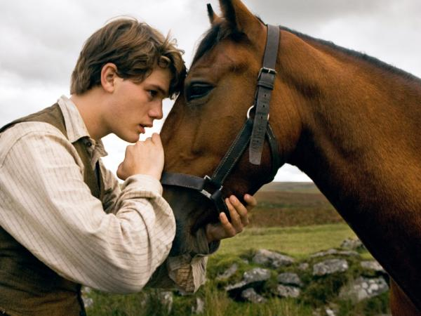 "Director Steven Spielberg delivers <a href=""http://www.npr.org/templates/story/story.php?storyId=143513144&live=1""><em>War Horse</em></a>, an unforgettable odyssey for Albert (Jeremy Irvine) and his horse Joey."