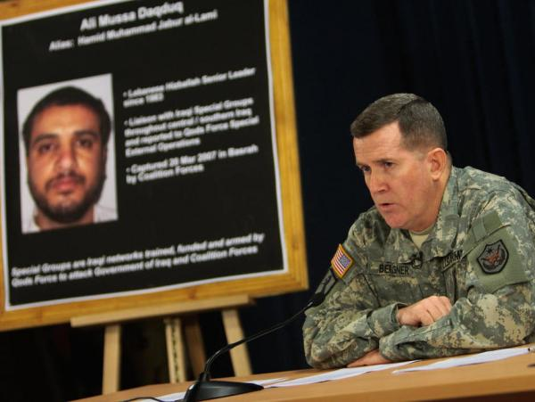 U.S. authorities decided to transfer Ali Mussa Daqduq — shown here on a poster at a 2007 U.S. military news conference in Baghdad — to Iraqi authorities.