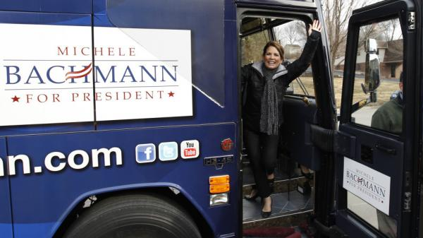 Rep. Michele Bachmann waves to supporters Friday in Sioux City before starting a 99-county bus tour of Iowa.