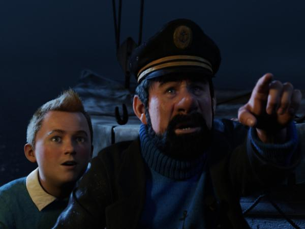 The young journalist Tintin (Jamie Bell, left) and the permanently drunk Captain Haddock (Andy Serkis<em></em>) go on a global treasure chase in <em>The Adventures of Tintin: Secret of the Unicorn. </em>