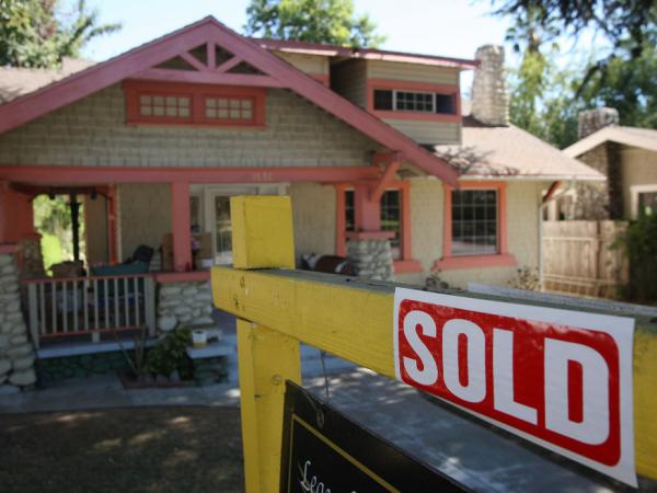 "A ""sold"" sign outside a home in Pasadena, Calif., in September 2009. New data show fewer such sales that year."