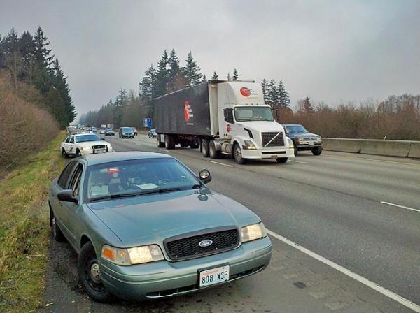 Cars and trucks on I-5 leave extra room for troopers by the side of the road. Photo by Austin Jenkins