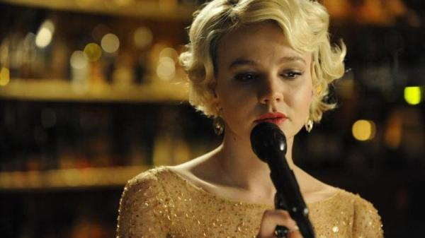 "In <em>Shame</em>, Sissy (Carey Mulligan) brings the memory of unspecified suffering to a strikingly hopeless reading of the usually upbeat ""New York, New York."""