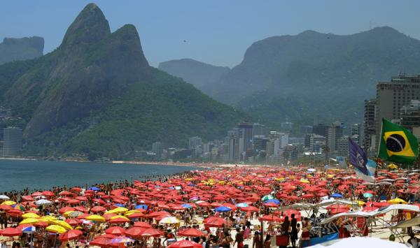 Thousands of people crowd Ipanema Beach in Rio de Janeiro, Brazil as summer gets going in the Southern Hemisphere.