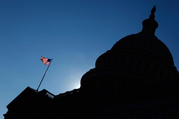 The flag waves in front of the U.S. Capitol.