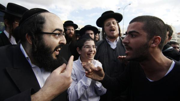 An ultra-Orthodox Jewish man (l) and a secular man argue during a protest against the strict religious codes favored by the ultra-Orthodox in the Israeli city of Beit Shemesh.