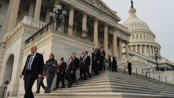 US Representatives walk down the House steps to leave for the Christmas holiday on Capitol Hill in Washington D.C.