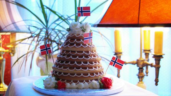 In Denmark they eat a towering cake called kransekage for New Year's Eve.