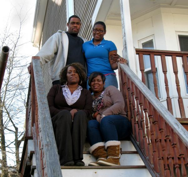 Sharon Jordan (lower left) and her family (clockwise from top left: Rydell, Nikera and Anisha) are working with Bank of America and a Boston nonprofit to repurchase their duplex at its current market price — about half of the original value.