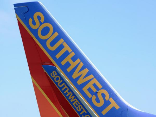 A Southwest Airlines passenger plane taxis on the tarmac at Los Angeles International Airport. Southwest and other smaller carriers have filed a lawsuit against new rules regarding airfare advertisements.