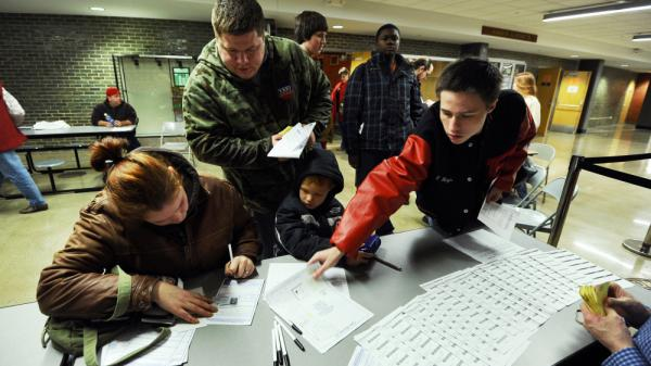 Voters register to cast their ballots during Republican caucuses at a school in Des Moines, Iowa, on Tuesday.
