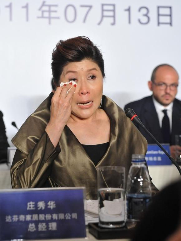 Doris Phua, chief executive of Da Vinci, answers questions during a press conference in Beijing in July, after CCTV accused it of selling fake furniture at high prices. Later, the company said it paid the CCTV reporter more than $150,000 through a public relations company to halt further stories.