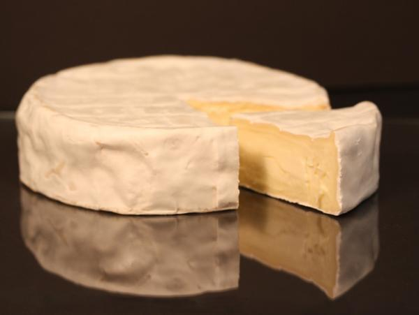 The downy white rind protects and keeps the inside of the cheese clean.