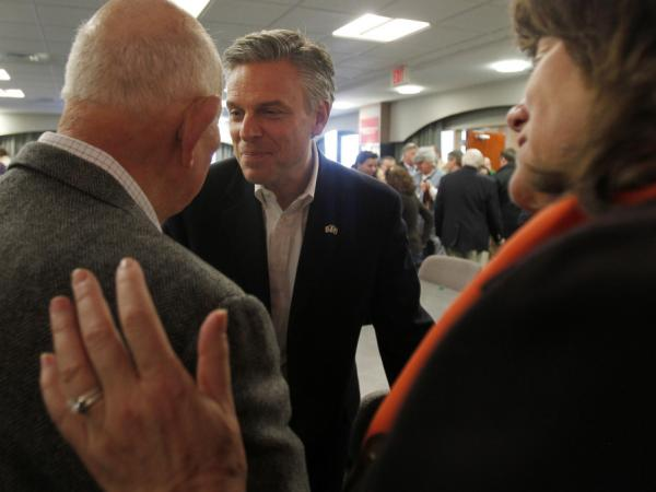 Former Utah Gov. Jon Huntsman shakes hands with voters following a business lunch campaign event in Portsmouth, N.H. on Jan. 5.