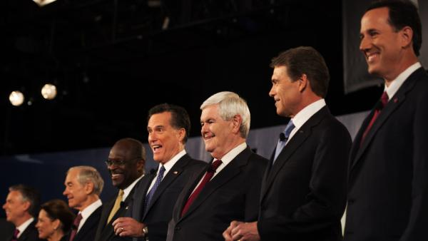 "Rick Santorum (right) was put on one end of the candidates, Jon Huntsman (far left) on the other during a Nov. 12 televised debate in South Carolina. During the debate, Huntsman complained about being ""a little lonely over here in Siberia,"" and Santorum responded: ""Tell me about it."""