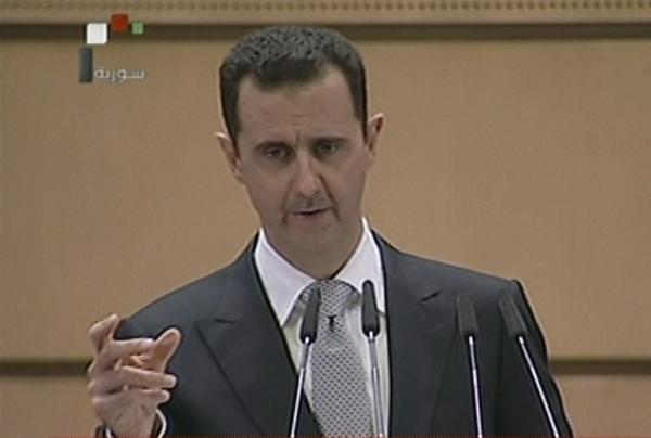 An image from Syrian state television shows Syrian President Bashar Assad delivering his speech Tuesday in Damascus.