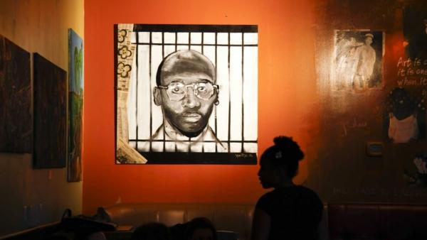A painting by a Haitian artist is on display in Washington, D.C.