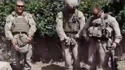 A still frame taken from a YouTube video purportedly shows Marines who desecrated three dead men  thought to be members of the Taliban in Afghanistan.