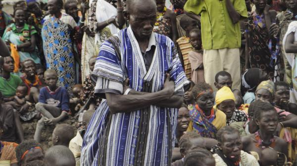 People who escaped ethnic violence in Jonglei state wait for food rations at a World Food Program distribution center on Thursday. South Sudan gained independence just six months ago, and already ethnic tensions inside the new country have forced tens of thousands to flee their homes.