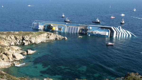 The luxury cruise ship Costa Concordia leans on its side after running aground in the tiny Tuscan island of Giglio, Italy.