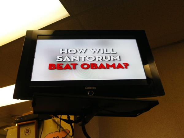 A political ad airs on a TV at Tommy's Country Ham House in Greenville, S.C., where Republican presidential candidate Rick Santorum was preparing to hold a campaign event.