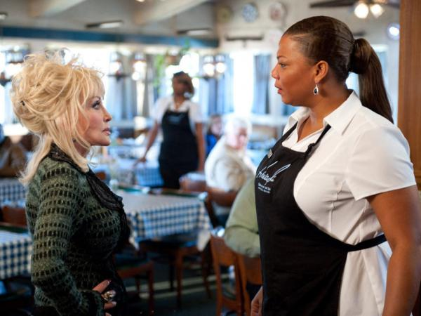 G.G. Sparrow (Dolly Parton) and Vi Rose Hill (Queen Latifah) clash in the new film <em>Joyful Noise</em>.
