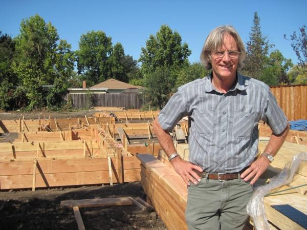 James Witt stands next to the foundation of a house he is building in Palo Alto. Witt has built a successful business by tearing down and rebuilding houses in Silicon Valley. His business has survived four recessions, including the most recent one.