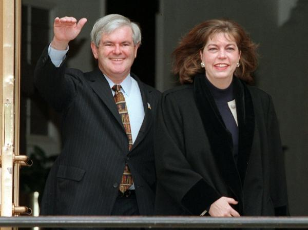 Former House Speaker Newt Gingrich and his then-wife, Marianne, leave their home on Tuesday, Jan. 7, 1997. At the time, Gingrich was in the midst of an investigation over congressional ethics violations.