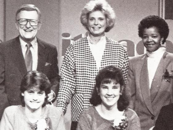 Host Mac McGarry (top left) poses with student contestants on the set of <em>It's Academic</em> in 1988.