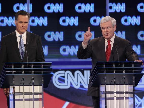 Newt Gingrich (right) responds to a question a question about things one of his ex-wives said about their marriage during last night's debate in South Carolina. Mitt Romney, looks on.