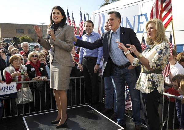 Republican presidential hopeful Mitt Romney and his wife Ann wish a happy birthday to South Carolina Gov. Nikki Haley (left) at Romney's campaign headquarters in Charleston, S.C., on Thursday.