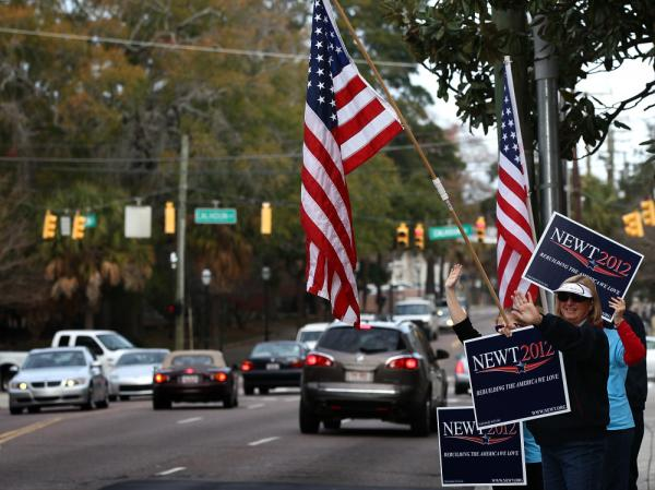 Supporters of former House Speaker Newt Gingrich campaign outside the Southern Republican Leadership Conference Friday in Charleston, S.C.