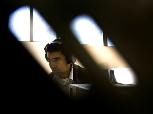 A member of Colombia's secret police, or Administrative Department of Security, listens to intercepted telephone calls in 2009. Reports of illegal wiretapping by secret police contributed to President Juan Manuel Santos' 2011 decision to close the agency.