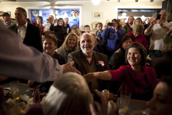 Former U.S. Sen. Rick Santorum shakes hands with supporters prior to speaking during a campaign stop at Captain Steve's Restaurant on Jan. 20 in Fort Mill, S.C. Fort Mill is just over the line from North Carolina, and some voters wish they could cross over for the GOP primary on Saturday.